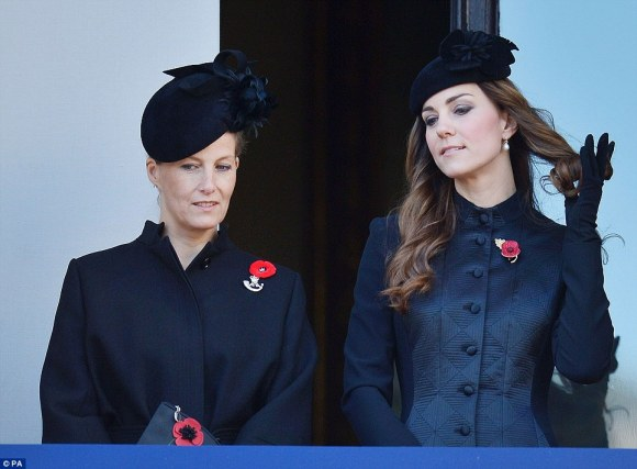 Daily Mail: The Duchess of Cambridge (right) plays with her hair as stands with Sophie, Countess of Wessex, on a balcony overlooking Whitehall's Cenotaph""