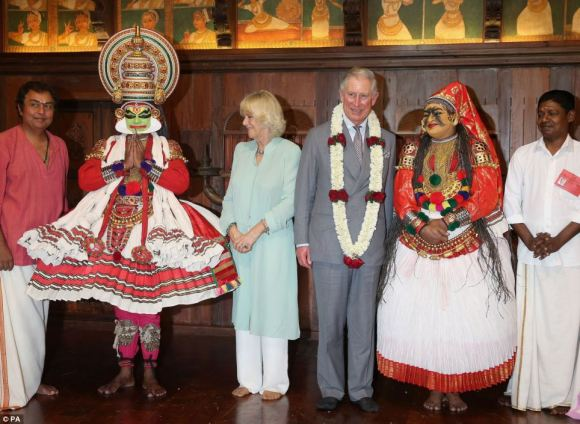 Prince Charles and Camilla meet dancers from the Kerala Folklore Theatre and Museum after a performance in Kochi