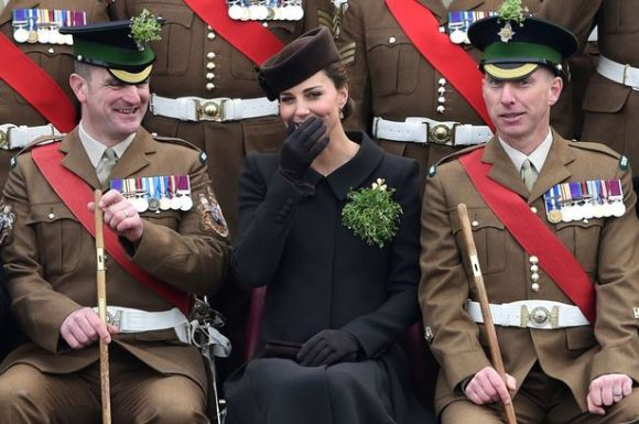 Duchess of Cambridge giggles during group photo (Photo: Getty)